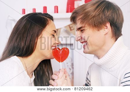 Cheerful Couple With Candy