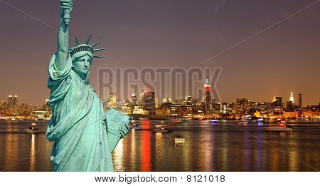 The Statue Of Liberty And New York City Skylines
