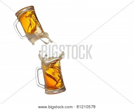 Beer mugs splashing on whire background