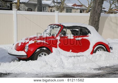 Car under snow in Brooklyn, NY after massive Winter Storm Juno strikes Northeast.