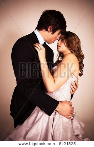 Attractive Young Couple Embracing For A Kiss