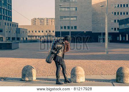 Beautiful Young Woman Carrying Saxophone Case