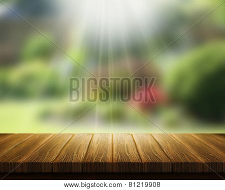 3D render of a wooden table looking out to blurred garden with sunrays