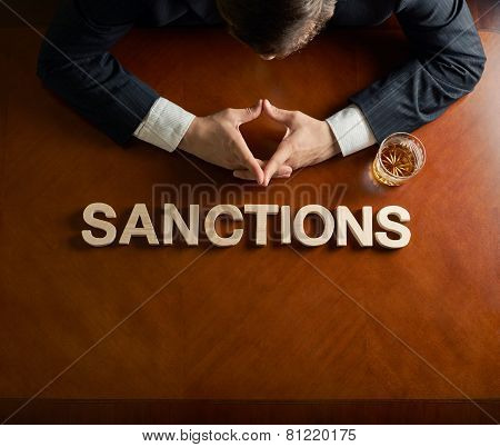 Word Sanctions and devastated man composition