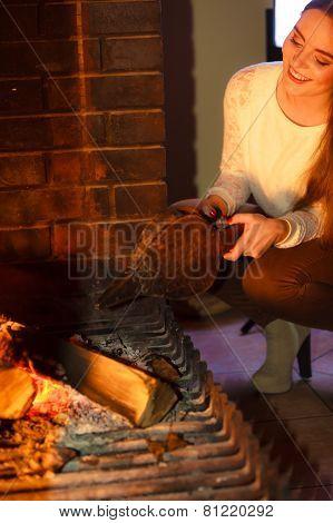 Girl Warming Up At Fireplace