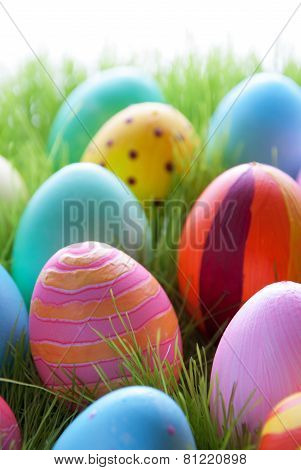 Green Grass With Many Colorful Easter Eggs