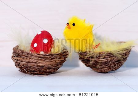 One Red Easter Egg And Yellow Chick In Nest