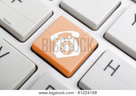 Orange phone key on keyboard