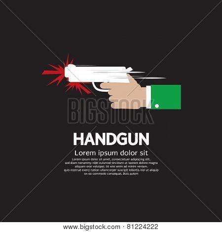 Hand Holding A Gun.