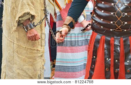 roman soldier and handcuffed  prisoner