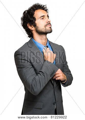 Portrait of a businessman adjusting his tie