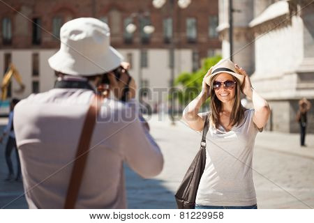 Man using his camera to take a picture of his girlfriend