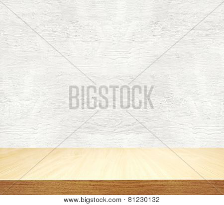 Grey cement wall and wooden desk