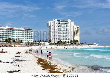 CANCUN - JANUARY 22: Tourists enjoy the sunny weather and relaxing on the beautiful beach on 22 January 2015 in Cancun, Mexico. This is one of the best beaches in the Mexico.