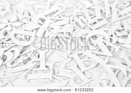 White Latin Letters on a white background. Selective focus. High key