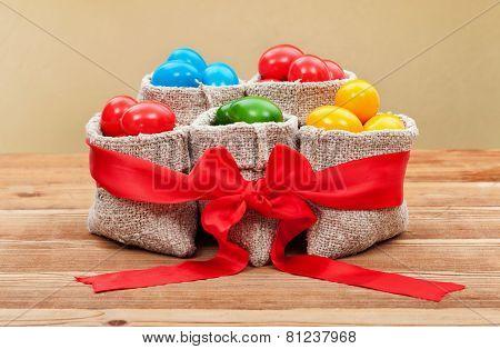 Colorful Easter Eggs In Burlap Bags - Festive Arrangement