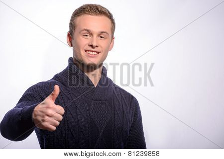 Young man showing his thumb up