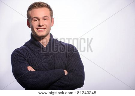Happy young man with hand beyond his head