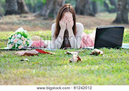 Woman Sitting On Wooden Mat And Closing Eye.