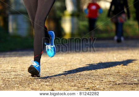 Athlete Runs In The Park During Training