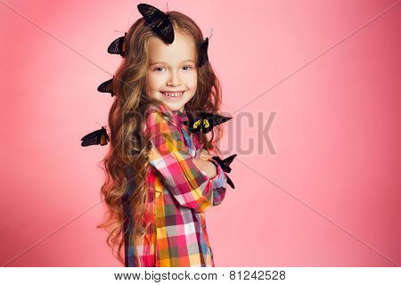 Studio portrait of a little girl with tropical butterflies.