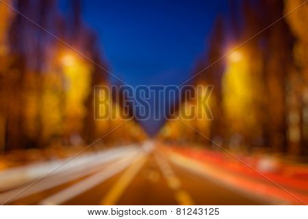 Blurred background of Europe street road in evening. Munich, Germany