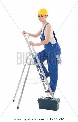 Young Woman Builder In Blue Coveralls With Toolbox, Screwdriver And Ladder Isolated On White