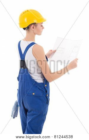 Back View Of Woman Builder In Blue Coveralls Holding Building Scheme Isolated On White