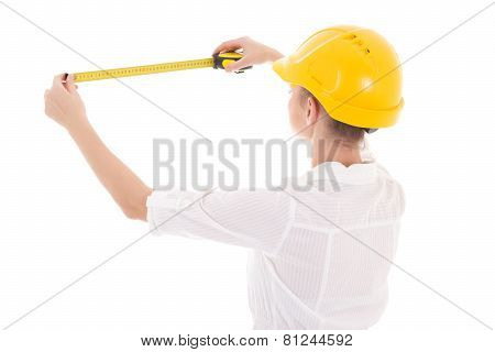 Back View Of Business Woman Architect In Yellow Builder Helmet With Measure Tape Isolated On White