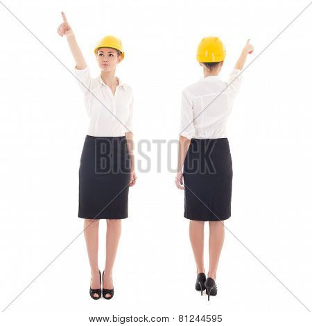 Front And Rear View Of Business Woman Architect In Yellow Builder Helmet Pointing At Something Isola