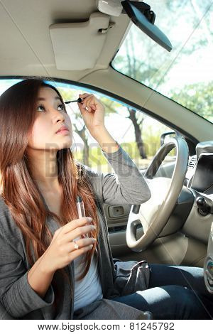 Young Woman Wearing Eyeliner In The Car