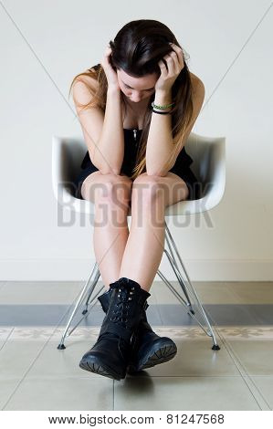 Depressed Young Woman Sitting At Home.