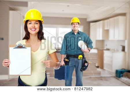 Group of professional construction workers in  new house. Renovation.