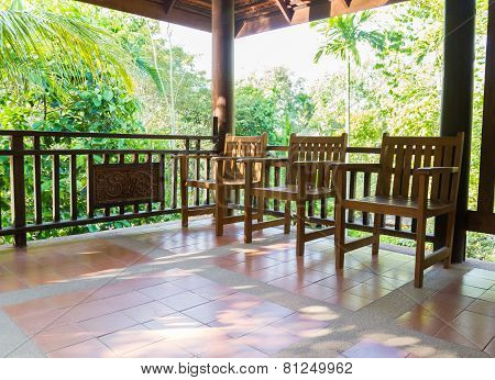 Wooden Chair On The Balcony