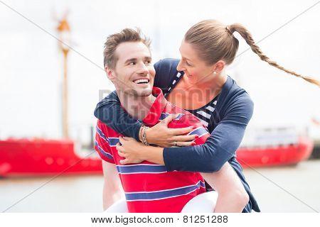 Couple enjoying vacation at German north sea ship pier in harbor