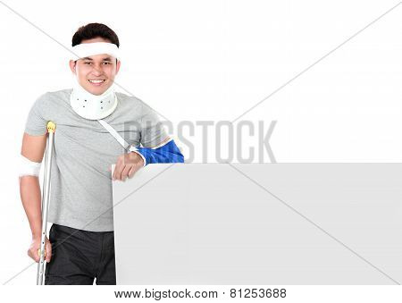 Injured Young Man Holding Grey Board