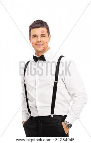 Lucky guy with a few kiss marks on his face isolated on white background