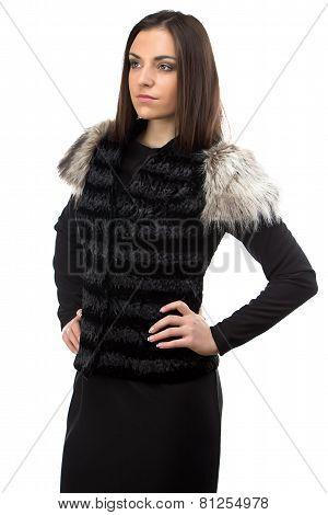 Image of attractive woman in black fur waistcoat