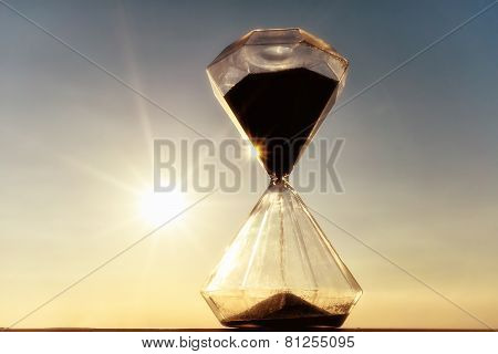 Hourglass On A Background Sunset
