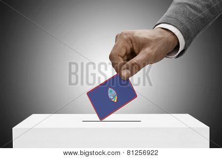 Black Male Holding Flag. Voting Concept - Guam