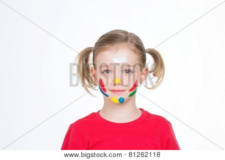 Young Child With Color On Her Cheek