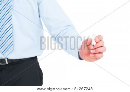 Businessman in shirt writing with a marker on white background