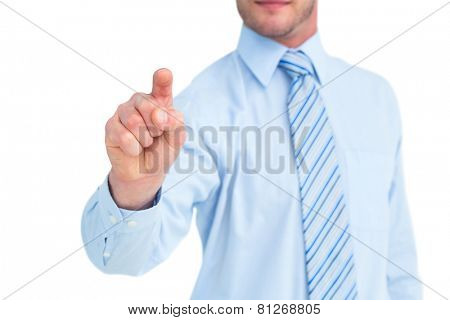 Businessman in shirt pointing with his finger on white background