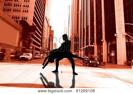 Ballerina leaping against new york street