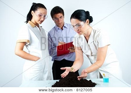 Scientists People Working In Laboratory