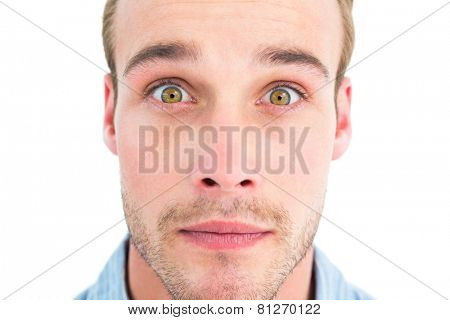 Surprised man in shirt looking at camera on white background