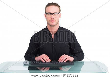 Focused businessman with reading glasses working on white background