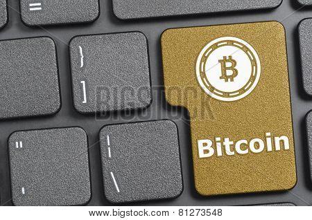 Golden bitcoin key on keyboard