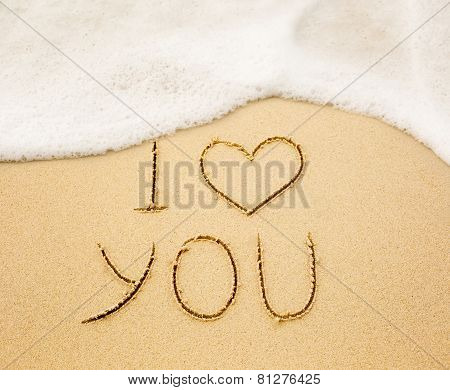 I Love You Written On Wet Yellow Beach Sand