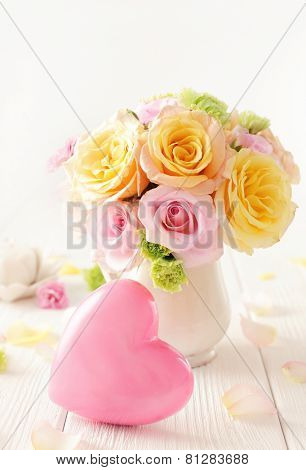 bouquet of flowers in a vase and pink heart. best for valentines day or wedding.